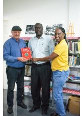 Mr. Julio R. Romney presents representatives of the Philipsburg Jubilee Library